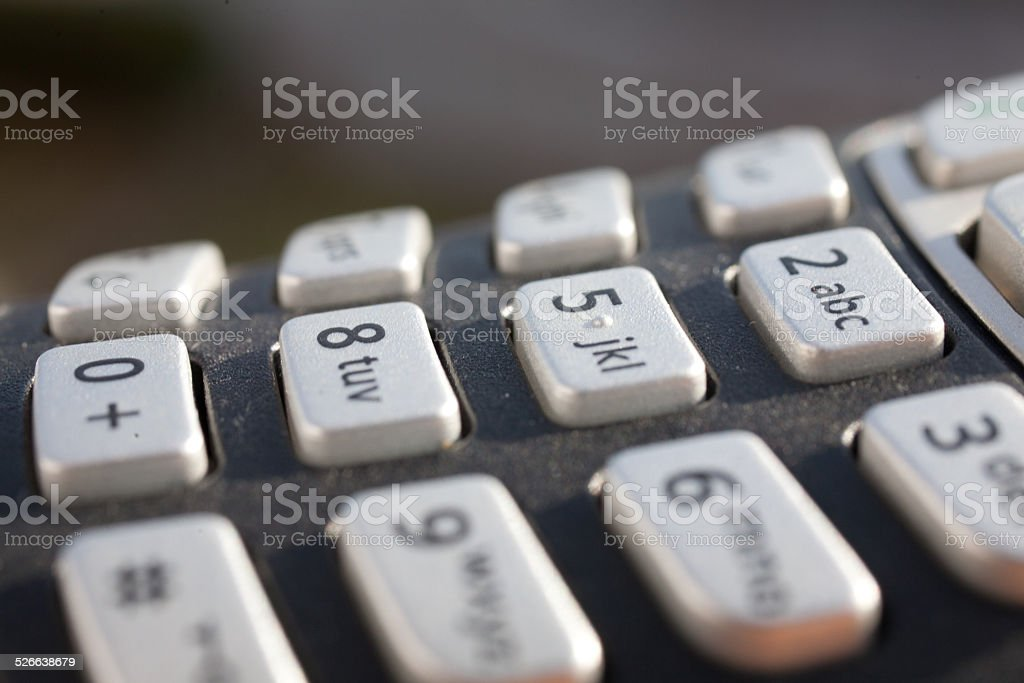closeup of a numeric keypad in direct sunlight stock photo