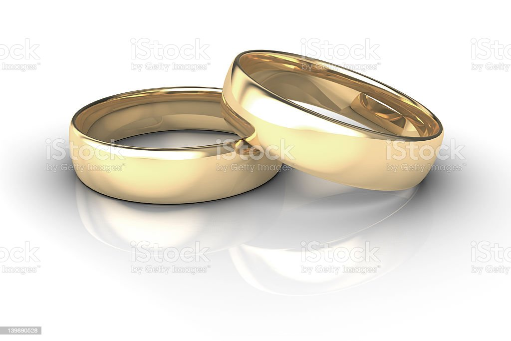 Closeup Of A Pair Of Golden Weddings Bands On White stock photo