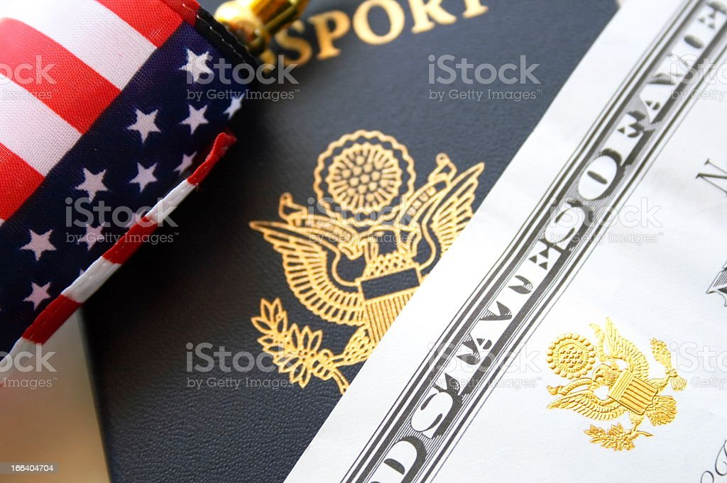 Close-up of a passport, USA flag and a dollar bill stock photo