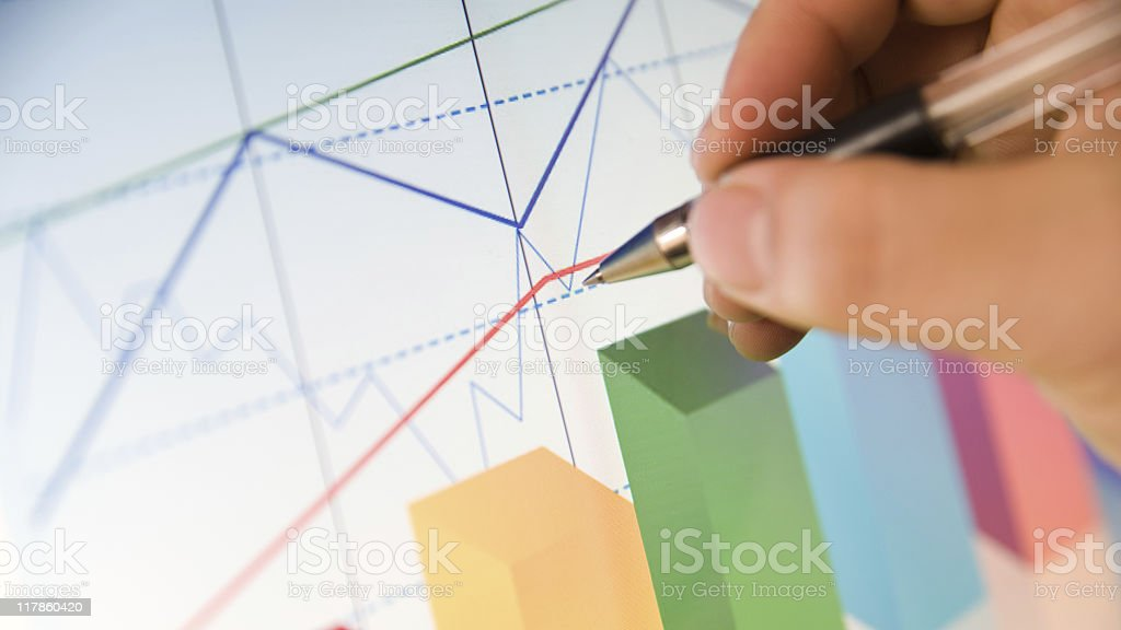 Close-up of a pen working on a colorful graph royalty-free stock photo