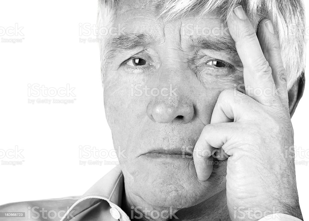 Closeup of a pensive retired man looking at you royalty-free stock photo