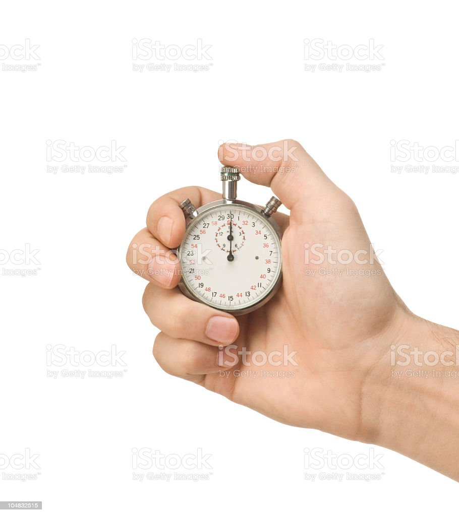 A close-up of a person holding a stopwatch stock photo