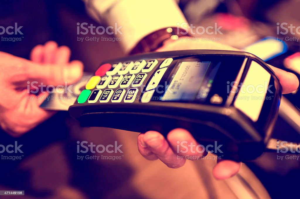 Close-up of a person using a credit card payment system stock photo