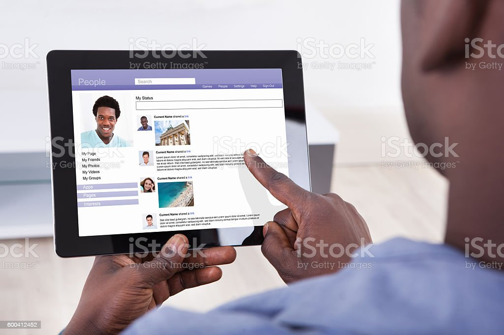 Close-up Of A Person Using Digital Tablet stock photo
