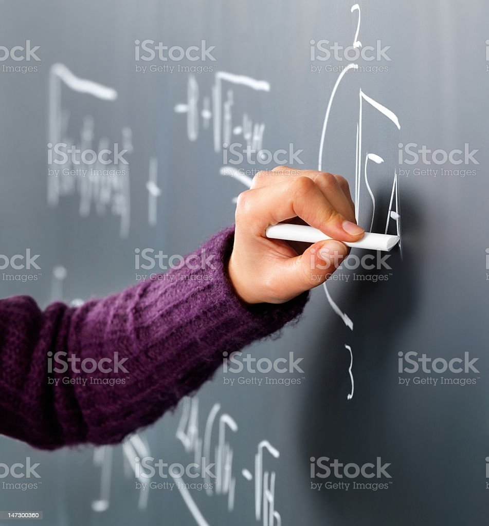 Close-up of a person's hand solving maths problem royalty-free stock photo