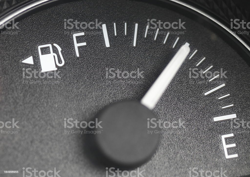 Close-up of a petrol gauge showing half full stock photo
