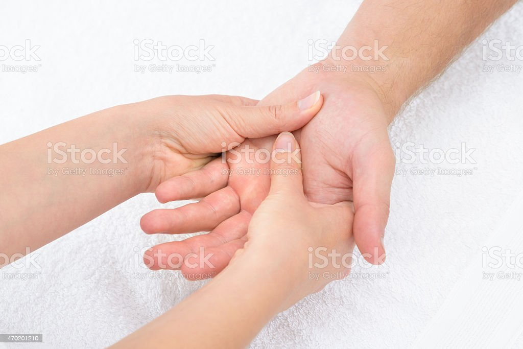 Close-up of a physiotherapist massaging a palm stock photo