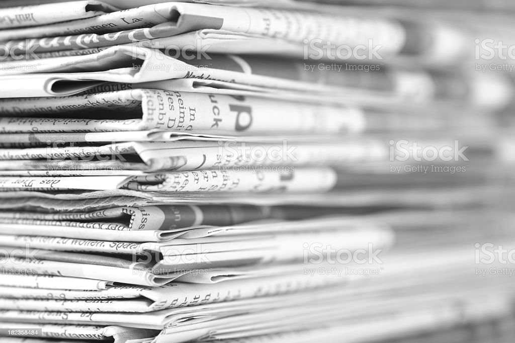 Close-up of a pile of newspapers royalty-free stock photo