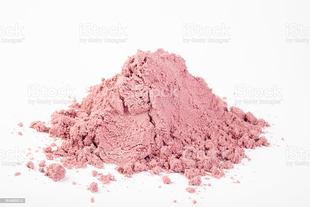 A close-up of a pile of powdered Acai stock photo