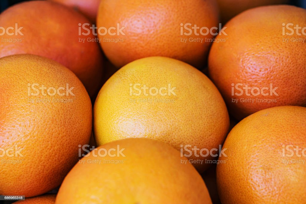 Closeup of a pile of ripe grapefruits. stock photo
