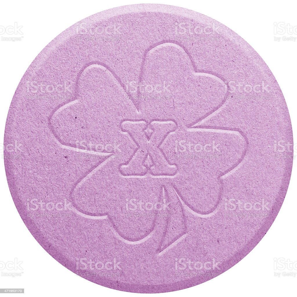 Close-up of a pink ecstasy pill stock photo