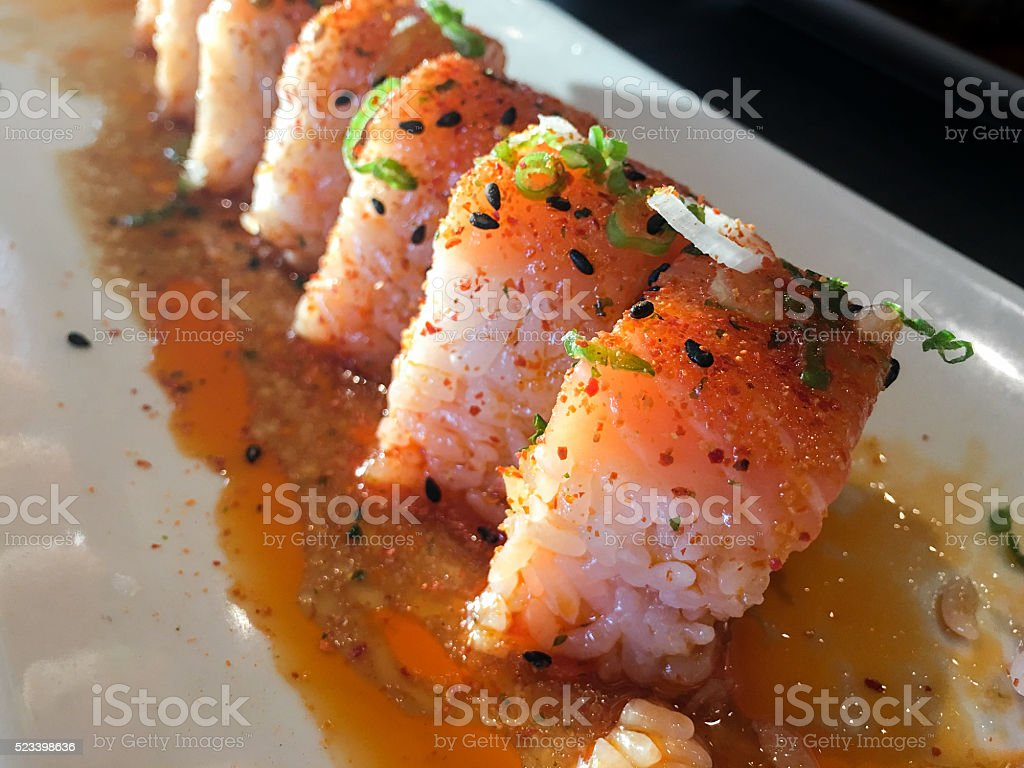 Close-up of a pink sushi roll on a plate stock photo