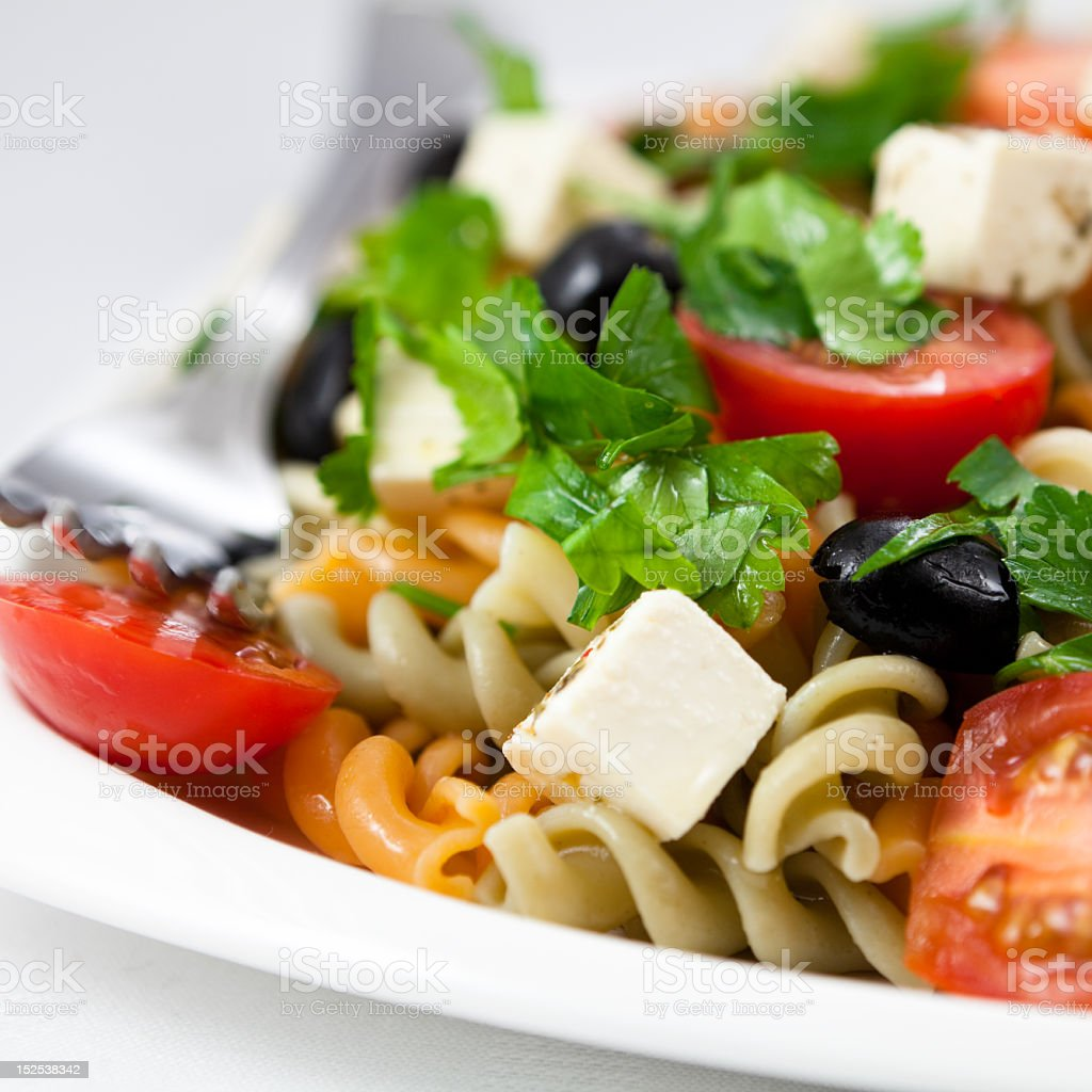 Close-up of a plate of a colorful pasta salad stock photo