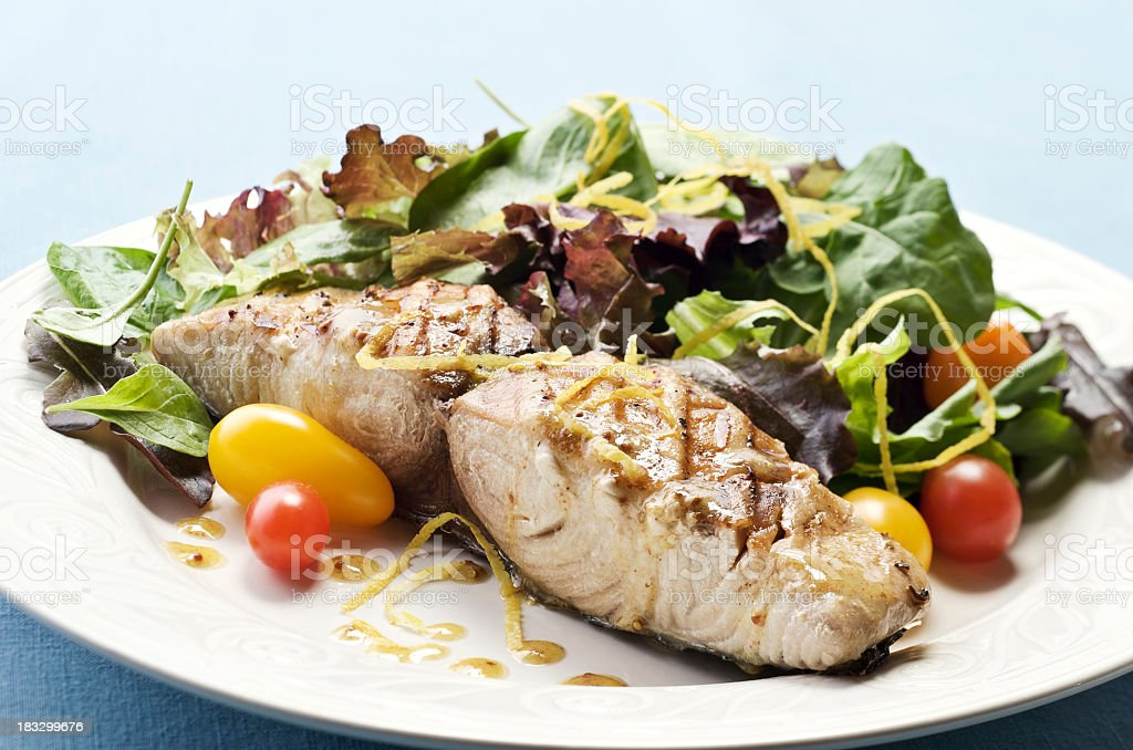 Close-up of a plate of grilled mahi-mahi stock photo