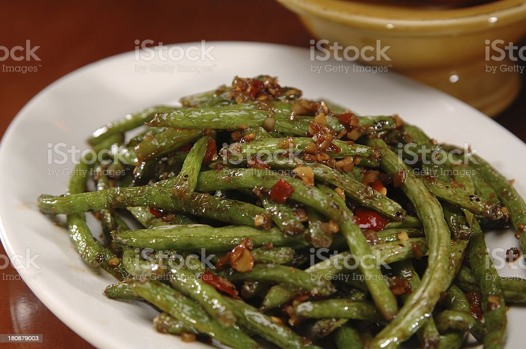 Close-up of a plate of spicy green beans stock photo