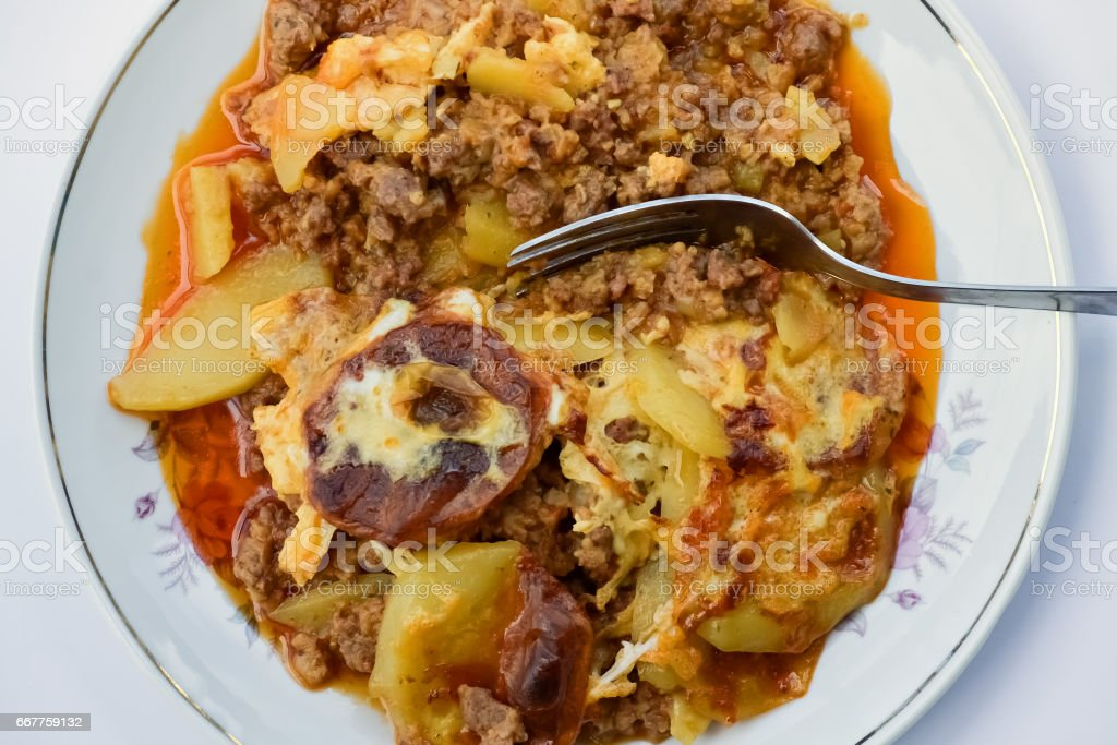 Closeup of a plate with moussaka on bright background stock photo