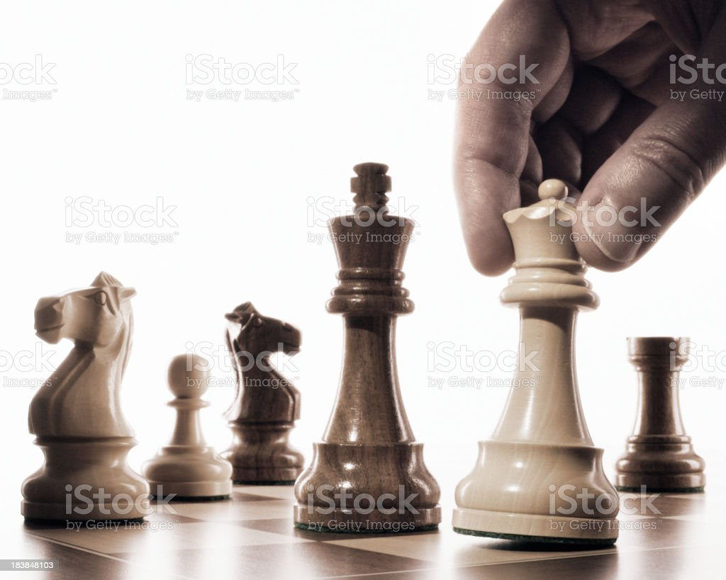 Close-up of a player moving the white queen into checkmate royalty-free stock photo