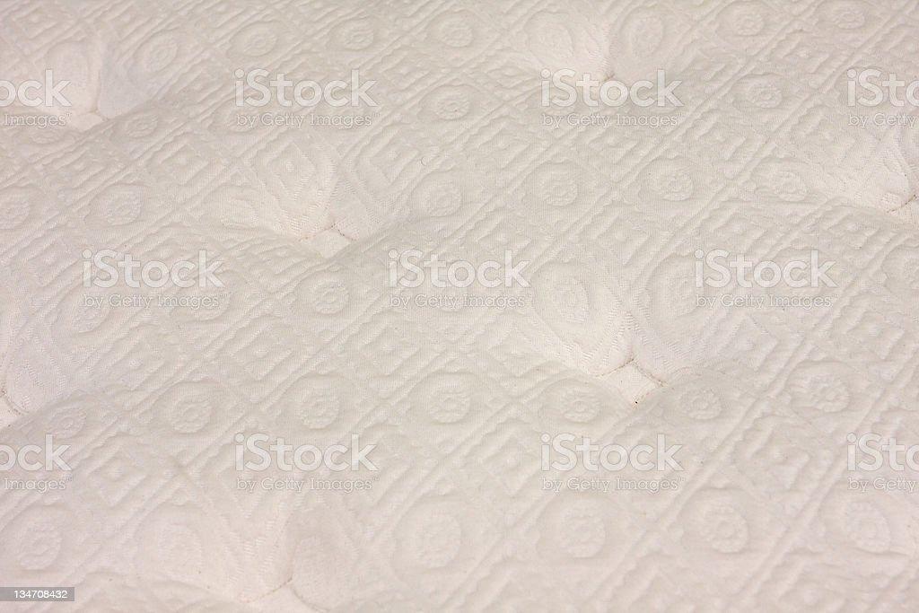 Close-up of a plush mattress fabric stock photo