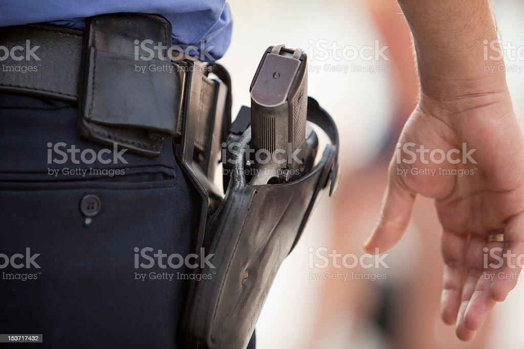 Close-up of a police officer's service revolver stock photo