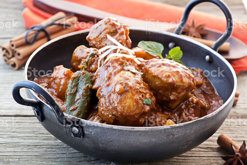 A close-up of a pot of chicken vindaloo royalty-free stock photo