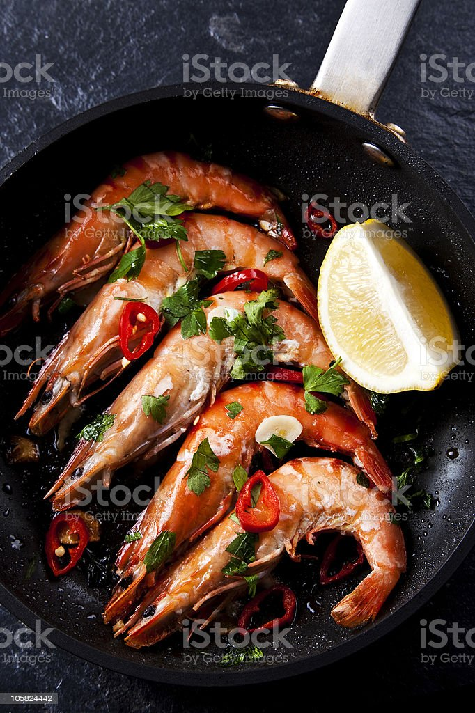 Close-up of a prawn dish with chilli and lemon royalty-free stock photo