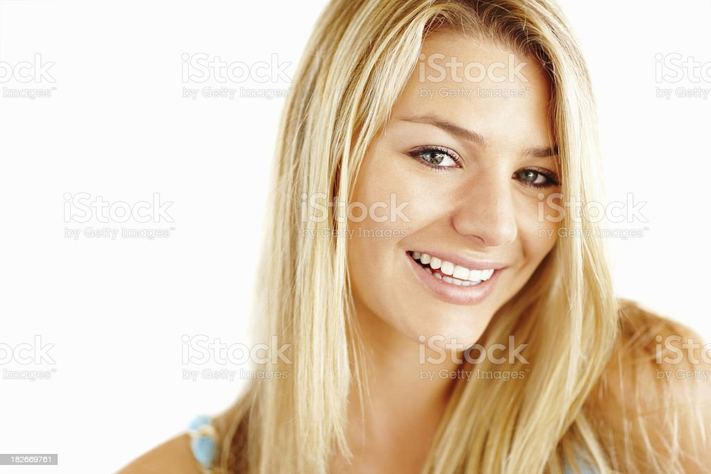 Closeup of a pretty blond female smiling on white royalty-free stock photo