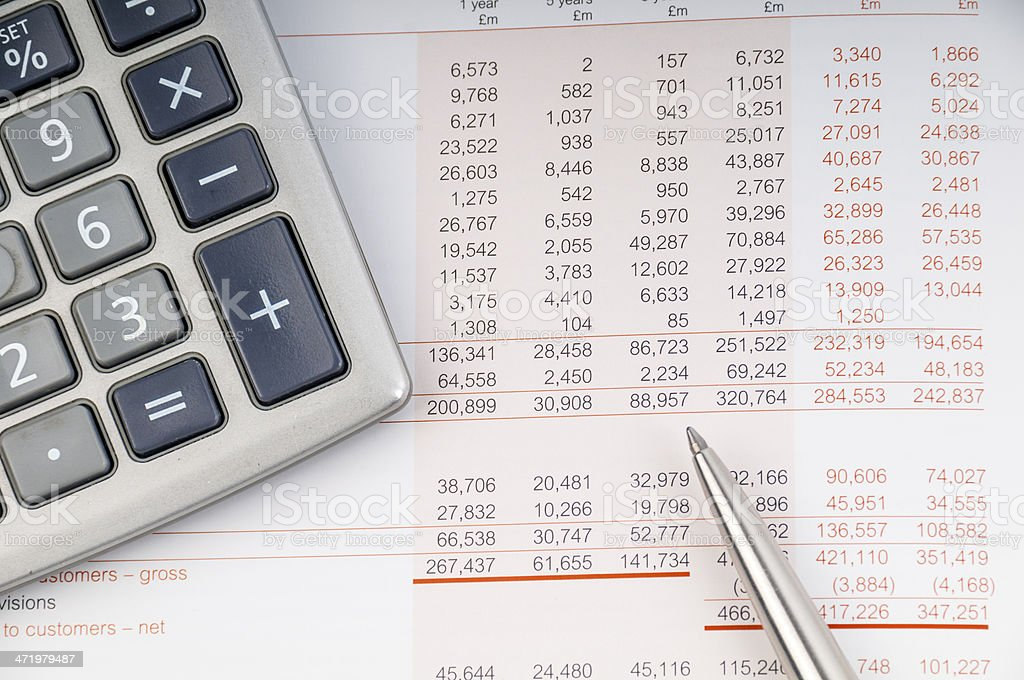 Close-up of a print out of a balance sheet with calculator stock photo