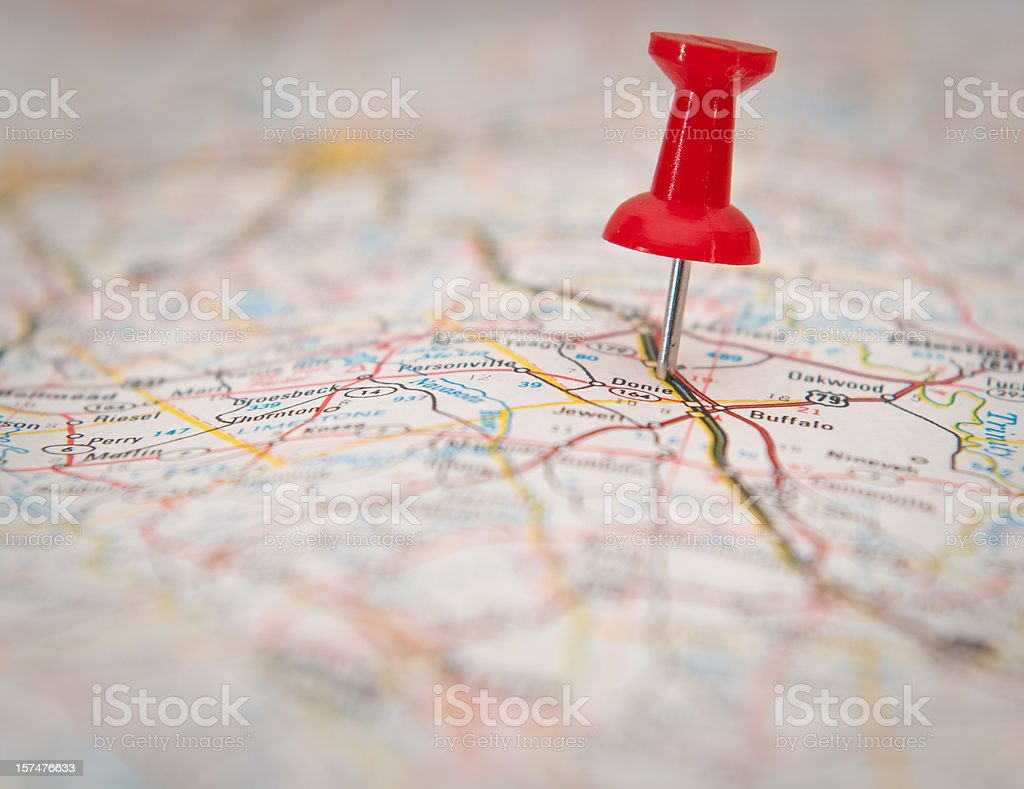 Close-up of a push pin stuck in a map stock photo