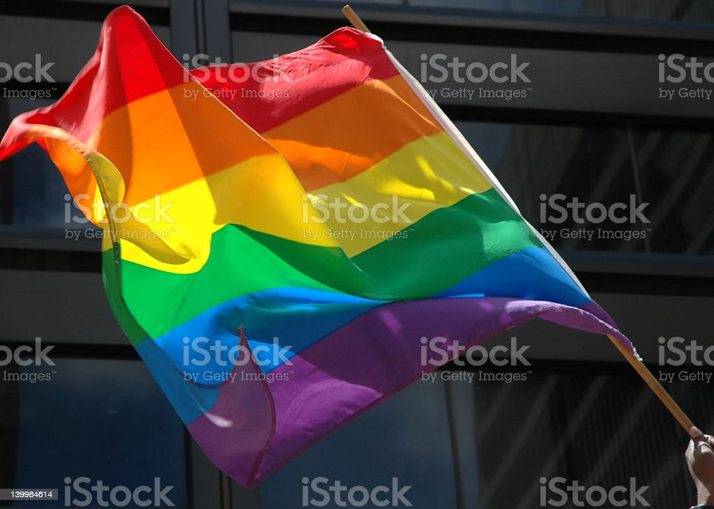 A closeup of a rainbow pride flag, waving in the wind stock photo