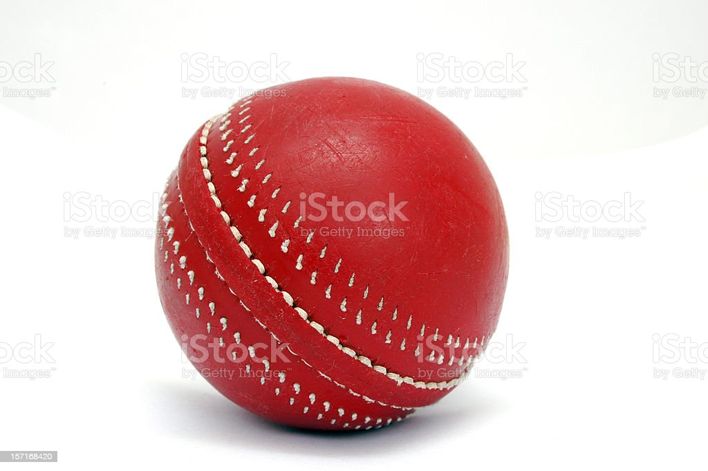 Close-up of a red cricket ball stock photo
