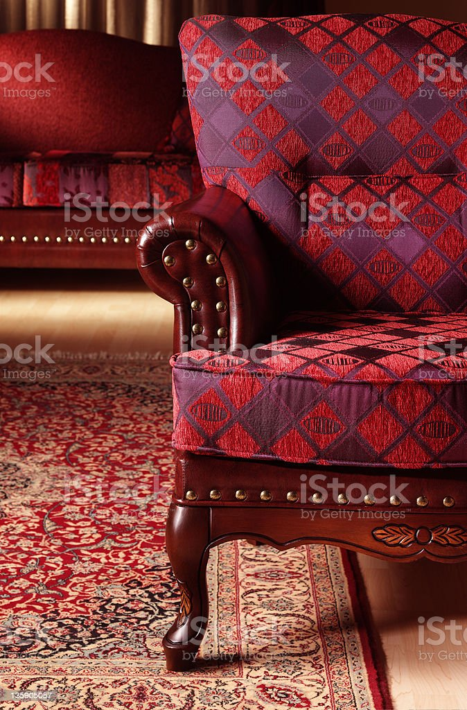Close-up of a red velvet sofa with red carpet and furniture royalty-free stock photo