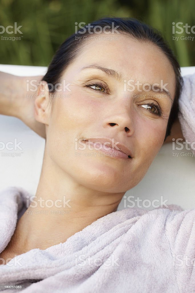Closeup of a relaxed thoughtful woman looking away royalty-free stock photo