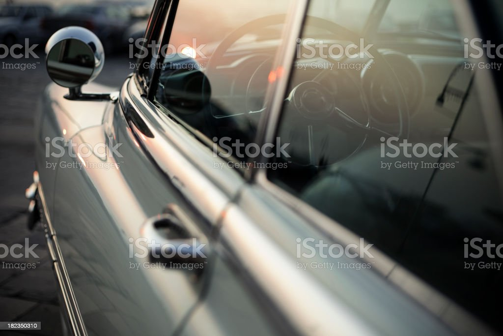 A close-up of a retro car at sunset royalty-free stock photo