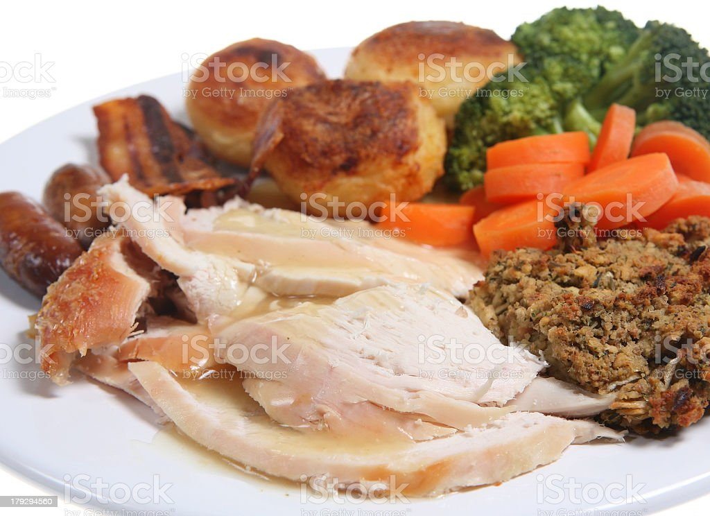 A close-up of a roast chicken dinner on a plate royalty-free stock photo