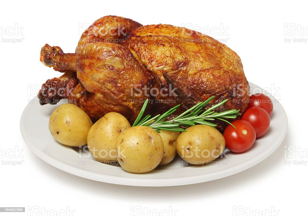 Close-up of a roasted barbecue chicken with potatoes royalty-free stock photo