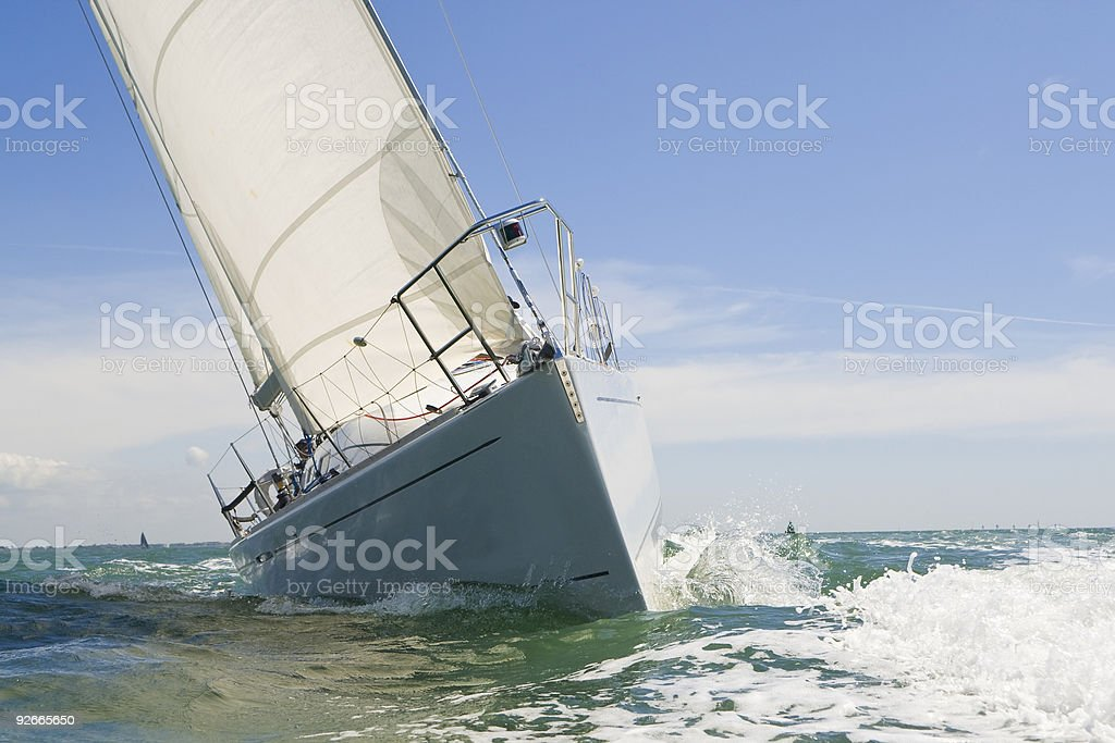 Close-up of a rocking sail boat on a sunny day royalty-free stock photo