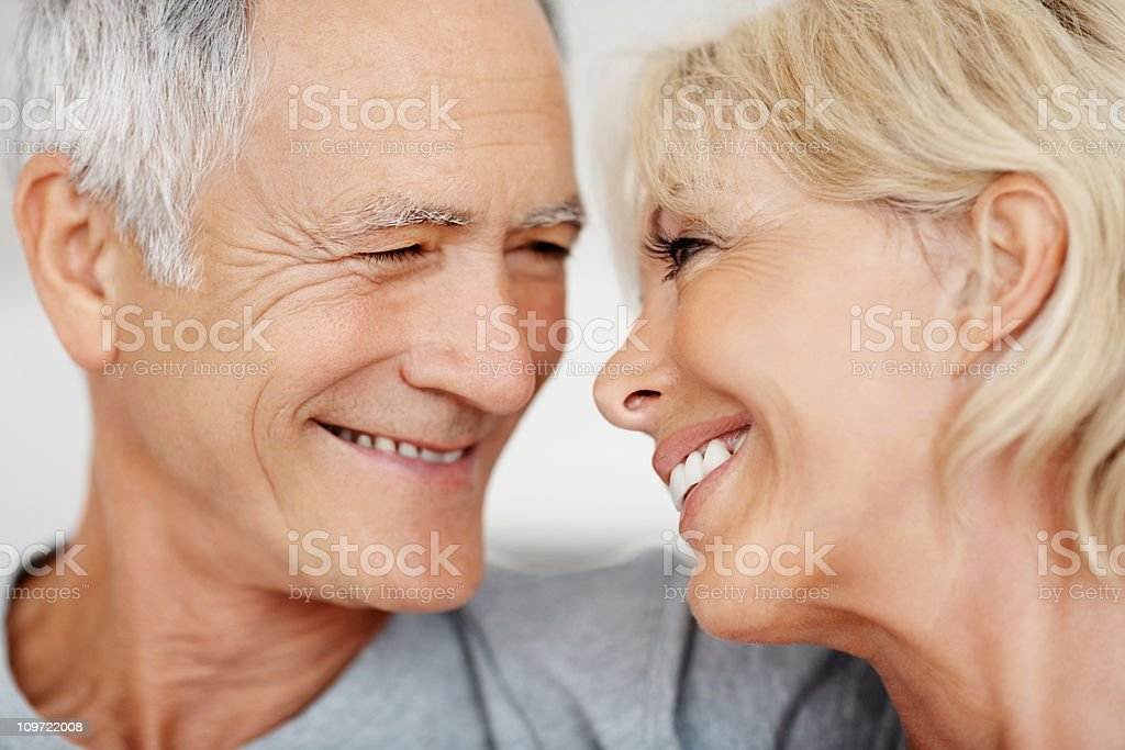 Closeup of a romantic mature couple smiling royalty-free stock photo