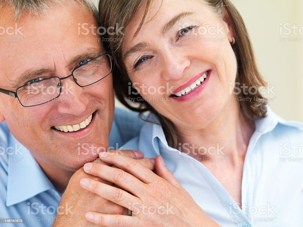 Close-up of a romantic senior couple smiling royalty-free stock photo