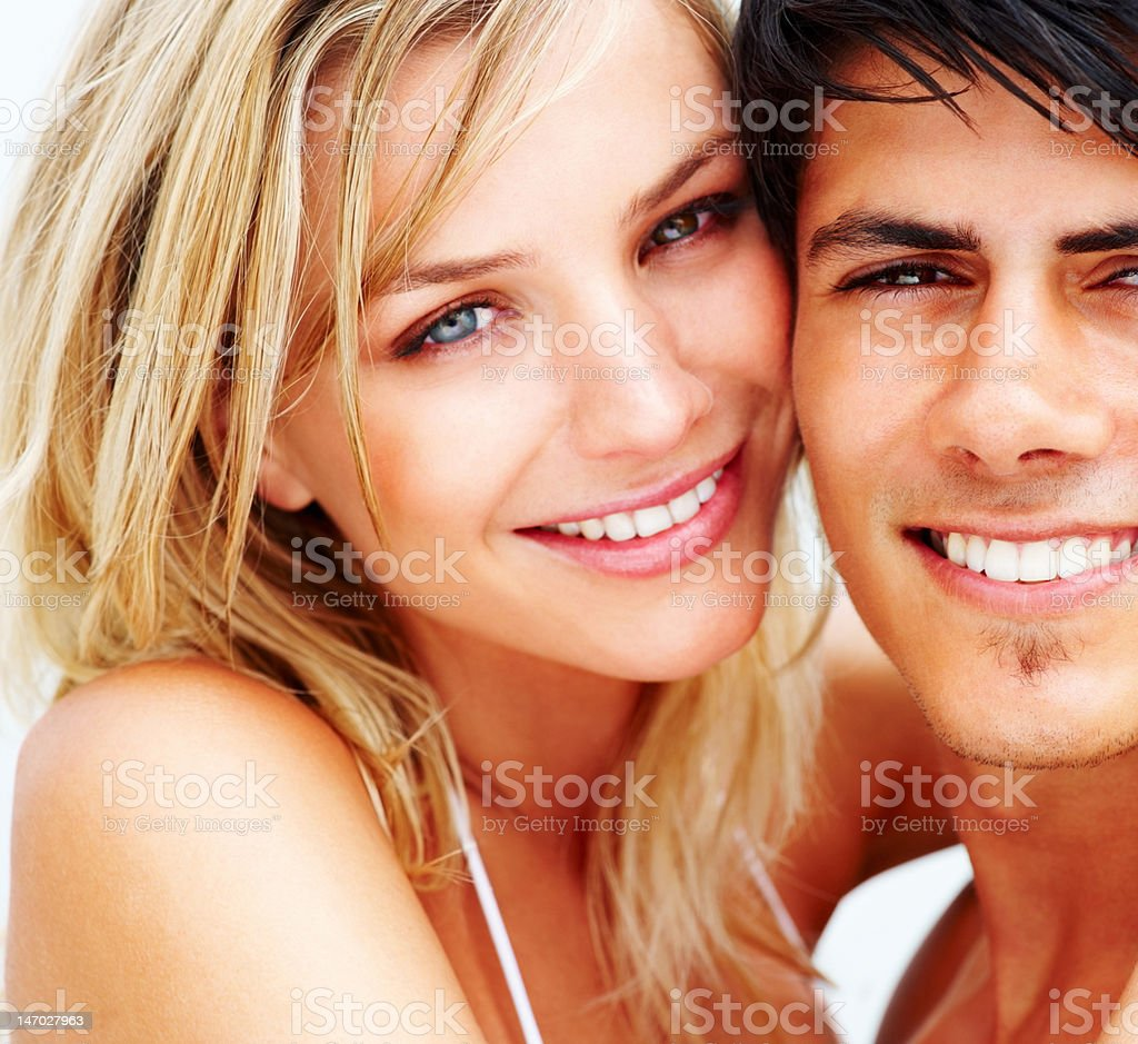 Close-up of a romantic young couple smiling stock photo