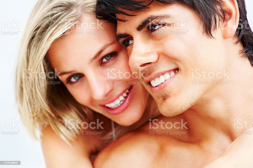 Close-up of a romantic young couple smiling royalty-free stock photo