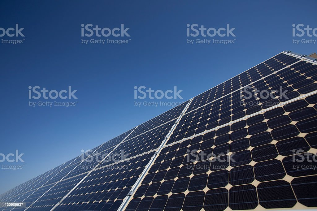 Close-up of a row solar panels under the blue sky stock photo