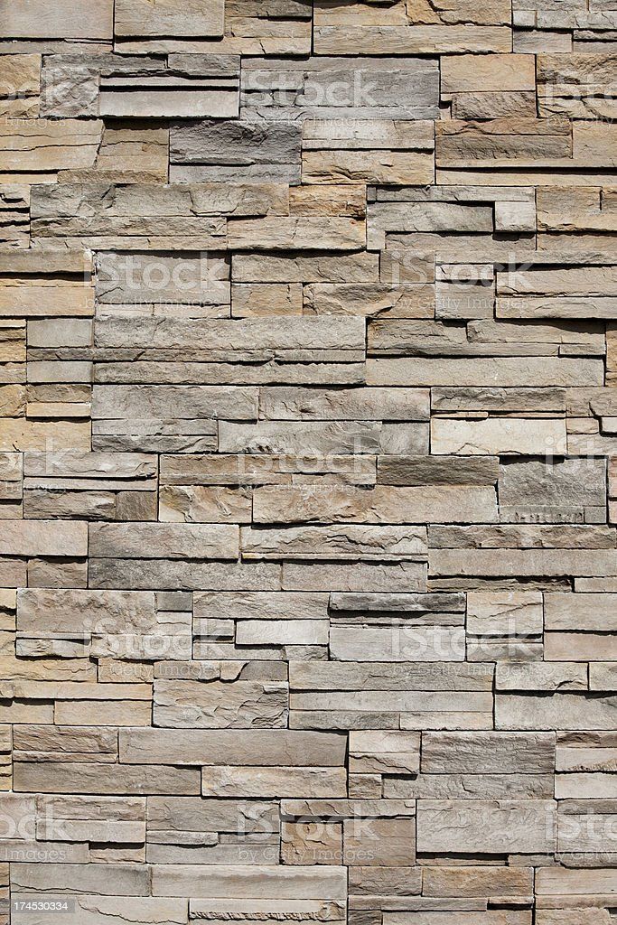 Closeup of a sandstone brick side of building stock photo