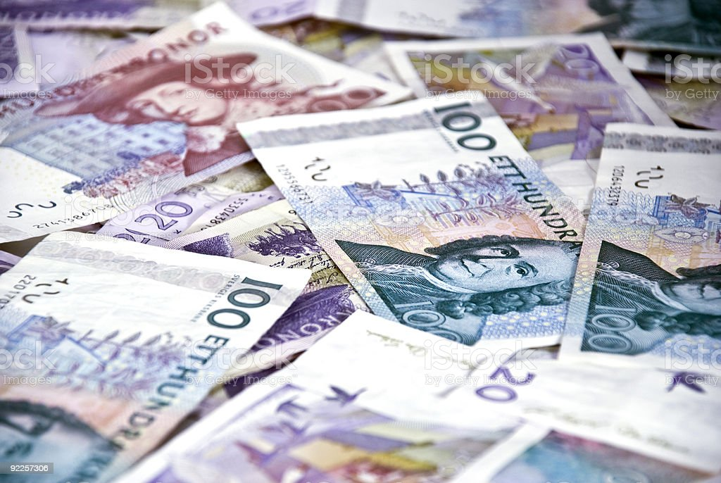Close-up of a scattered pile of Swedish krona notes stock photo