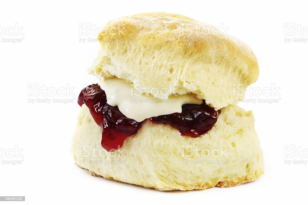 Close-up of a scone with jelly and butter isolated on white stock photo
