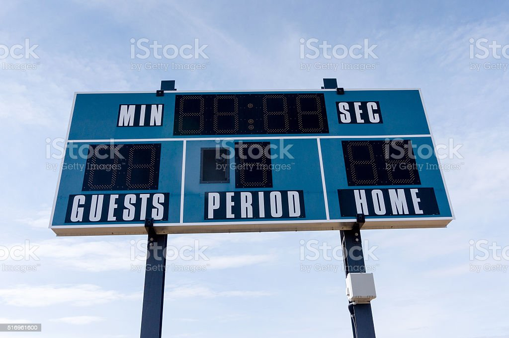 Closeup of a Scoreboard at Local Football Field stock photo