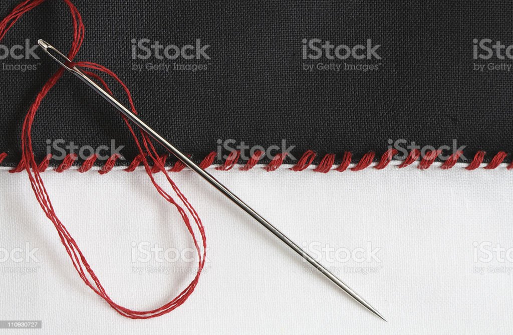 A close-up of a seam and needle royalty-free stock photo