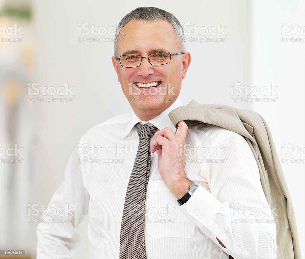 Close-up of a senior businessman smiling royalty-free stock photo