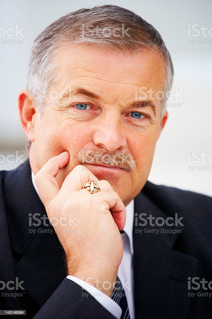 Close-up of a senior businessman thinking royalty-free stock photo