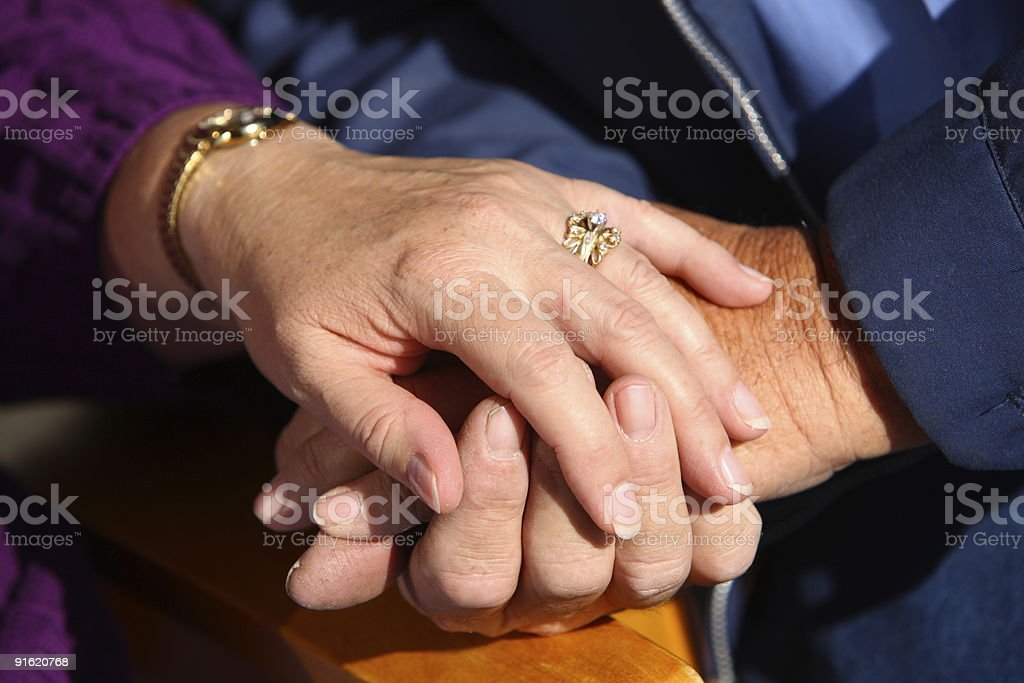 Close-up of a senior couple holding hands royalty-free stock photo