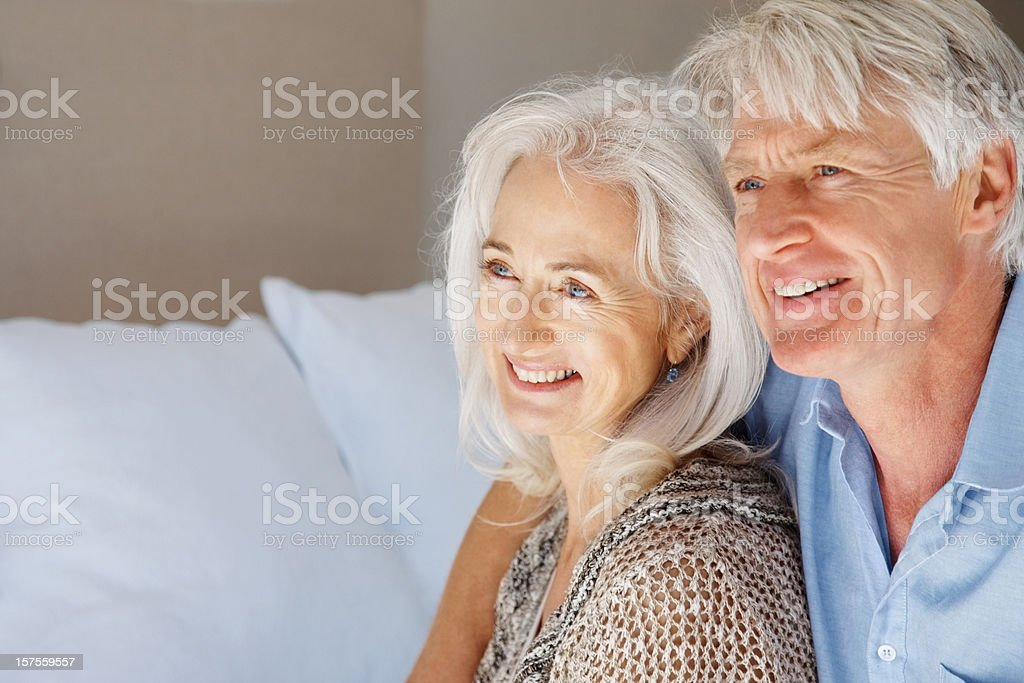 Close-up of a senior couple smiling and looking away royalty-free stock photo